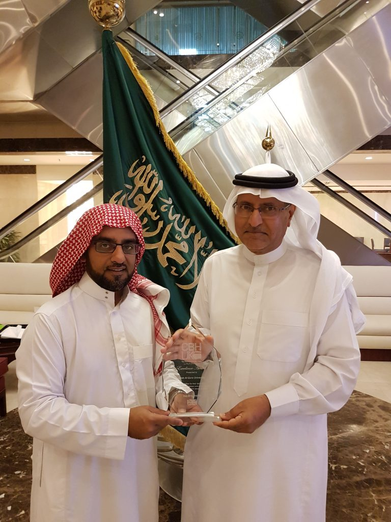L-R (Rashid Mogradia handing the award to Prof. Ramze Elzahrany).