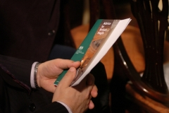 A guest holds a leaflet at the launch of the 10th British Hajj Delegation in London, 27 October 2009